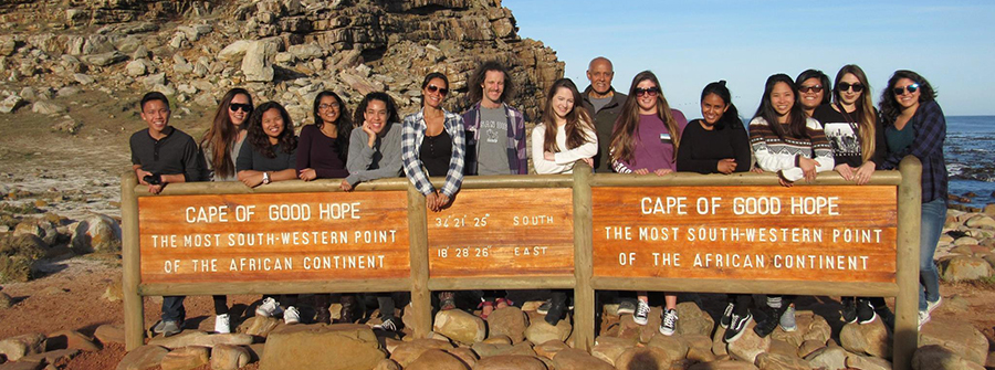 Group of students standing behind Cape of Good Hope sign