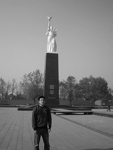 Standing by statue in Nanjing